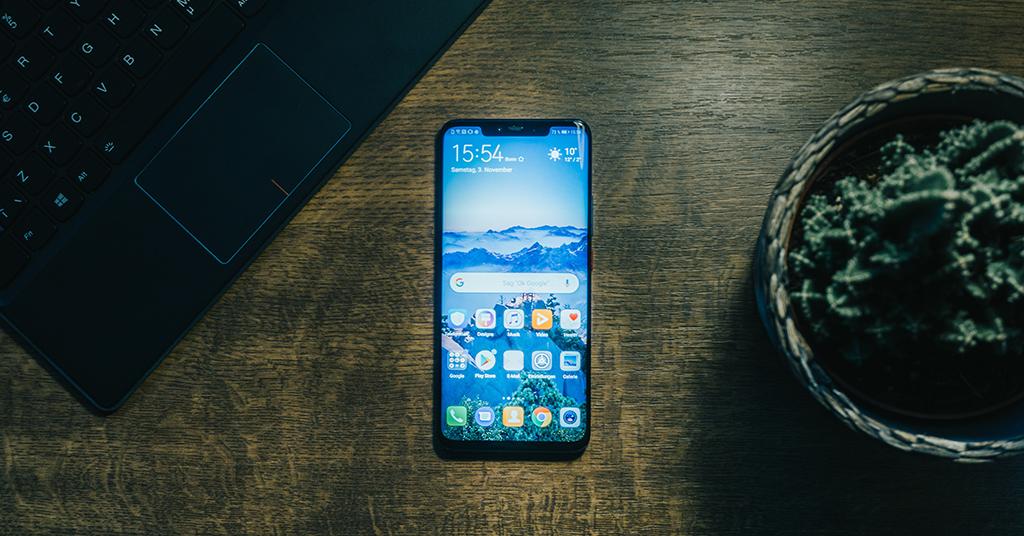 black iPhone on desk
