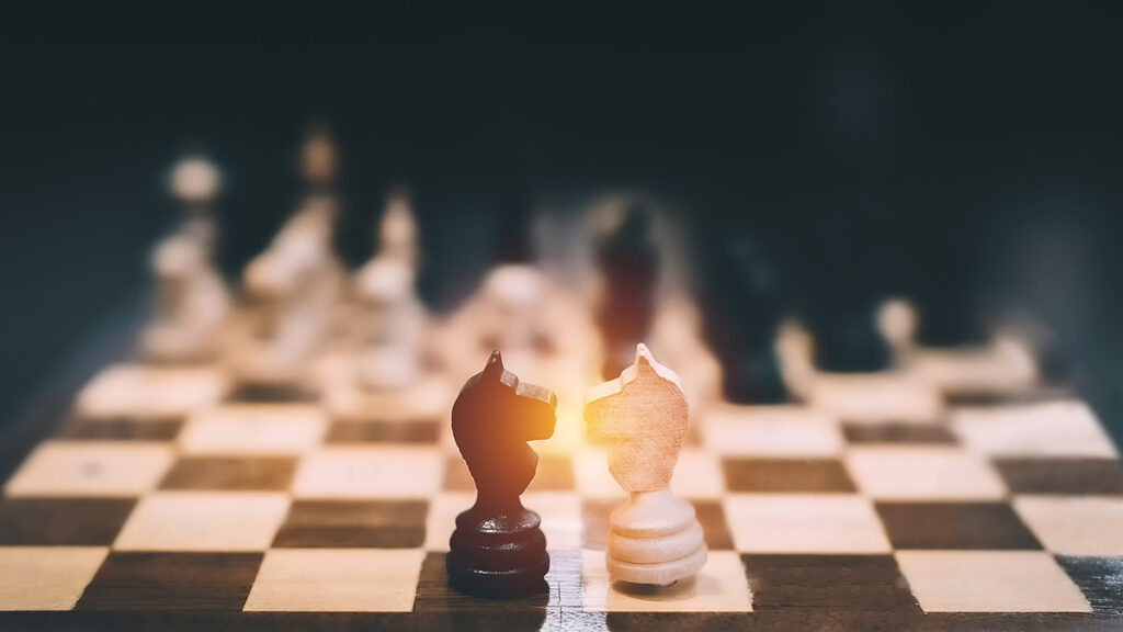 Knight Vs Knight chess pieces on chessboard